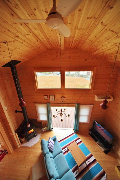 cozy-wooden-green-cottage-house-6