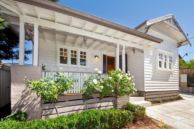 1 storey white vintage house with traditional veranda (1)