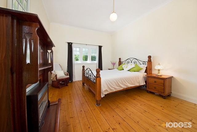 1 storey white vintage house with traditional veranda (5)