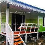 แบบบ้านยกพื้นแต่งผนังไม้โทนสีเขียว ร่มรื่นอย่างเรียบง่าย ในงบประมาณไม่เกิน 600,000 บาท