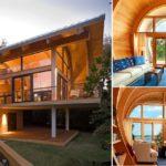 บ้านพักตากอากาศยกพื้นสไตล์โมเดิร์น ทำจากไม้โอ๊คสีอ่อน แต่งแต้มด้วยแสงไฟโทนสีส้มอบอุ่น สร้างบรรยากาศให้บ้านน่าอยู่มากขึ้น