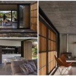 บ้านโมเดิร์นหน้ากว้าง ตกแต่งด้วยปูนเปลือยผสมไม้ เน้นความเรียบง่ายด้วยด้วยโครงสร้างแบบดิบๆ
